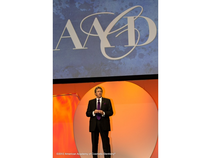 AACD President, Dr. John Sullivan speaks on-stage