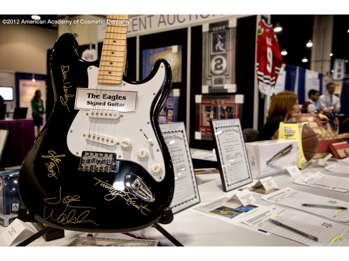 Give Back a Smile Silent Auction items included a signed guitar by famous rockstars.