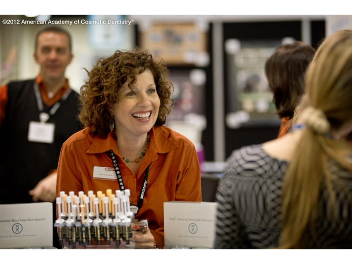 Attendees greeted with smiles at the Exhibit Hall.