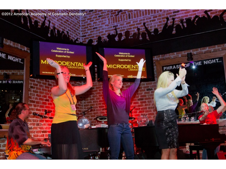 Attendees dance and have fun at the Give Back a Smile Fundraiser event at Bobby McKey's.